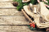 image of candy cane border  - Christmas table setting in retro style on wooden table