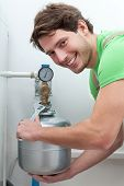 Happy Man Repairing Boiler