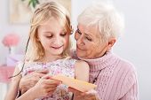 stock photo of grandma  - A grandma with a birthday card from her granddaughter - JPG