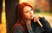 Young woman outdoors autumn portrait.