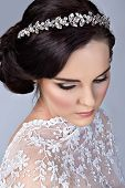 picture of bohemian  - Beautiful young bride with wedding makeup in romantic lace dress on studio background - JPG