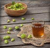 Harvest Of Hops And A Glass Cup With A Drink From The Hops