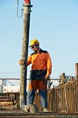 image of formwork  - builder worker standing near trailer - JPG
