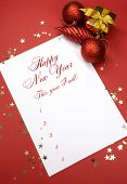 Happy New Year Resolutions Writing On Notepad Paper, This Year I Will, List Of Goals Against A Red B