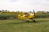 Single Engine Aeroplane Parked On Grass