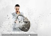 Image of businesswoman crashing lock with hand