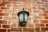 Forged lantern on a brick wal