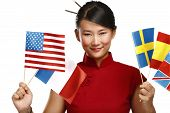 stock photo of citizenship  - Beautiful asian woman showing multicolor international flags on white - JPG