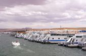 foto of houseboats  - Pier for houseboats in Lake Powell USA - JPG