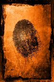picture of crime solving  - a fingerprint on a textured grunge background - JPG