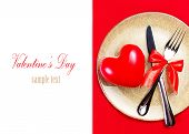 Valentines Day Background With Hearts On A Golden Plate Over Red Cloth Isolated On White. Knife And