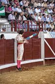 Spanish bullfighter Juan Jose Padilla jumping and suspended in the air with two banderillas