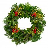 Christmas holly wreath isolated on a white background.
