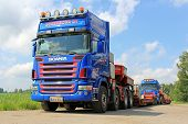 Two Scania V8 Trucks With Drop Deck Trailer