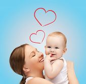 family, children, parenthood and happiness concept - happy mother with adorable baby