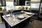picture of kitchen appliance  - Modern designer kitchen with a granite island - JPG