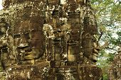 Carved Stone Faces At Ancient Temple In Angkor Wat, Cambodia