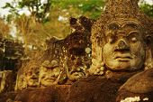 Carved Stone Heads At Ancient Temple In Angkor Wat, Cambodia