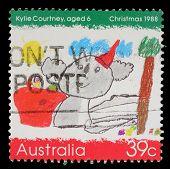 AUSTRALIA - CIRCA 1988: a stamp printed in the Australia shows Koala Wearing a Santa Hat, by Kylie Courtney, Childrens Design, Christmas, circa 1988
