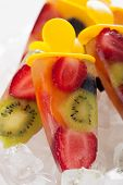 frozen strawberry,kiwi,peach and coconut water popsicles