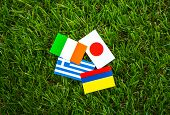 Paper cut of flags on grass for Soccer championship 2014 , group C