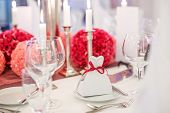 Elegant Table Set  For Wedding Or Event Party In Soft Red And Pink, With Paper Bride And Groom.
