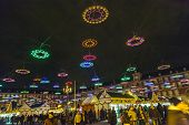 People Shop At Illuminated Christmas Market In Madrid