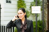 Real estate - Young Indonesian realtor showing an house or apartment, it could be the landlord too,