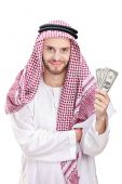 Young Arab businessman holding US dollars