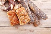 stock photo of pretzels  - mix of fresh homemade baguettes  - JPG