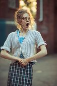 Funny Crazy Girl Student In Glasses And A Vintage Dress