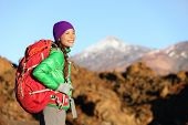 Active woman hiker living healthy lifestyle hiking outdoors wearing backpack smiling happy. Beautifu