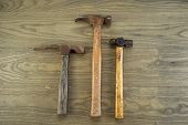 image of peen  - Horizontal photo of old masonry claw and ball peen hammers on aged wood - JPG
