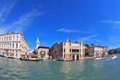 VENICE, ITALY - SEPTEMBER 9, 2010: Magnificent Venetian palace on sunny day, surrounded by the waters of the channel. Photo taken by lens Fisheye