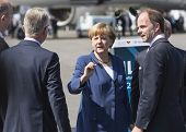BERLIN, GERMANY - MAY 20, 2014: German Chancellor Angela Merkel and CEO Mr Christian (C.-R.) open up the International aviation and space exhibition ILA.