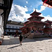 Nepalese people and tourists visiting most famous attraction Bhaktapur Durbar square. Kathmandu