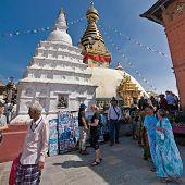 Nepalese People And Foreign Tourists Visiting Buddhist Shrine Swayambhunath Stupa. Nepal