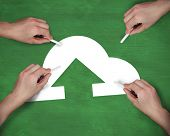 Composite image of multiple hands writing cloud computing icon with chalk against green
