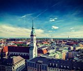 Vintage retro effect filtered hipster style travel image of aerial view of Munich and St. Peter Chur