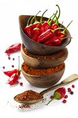 picture of chili peppers  - Red Hot Chili Peppers with herbs and spices over white background  - JPG