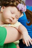 sleaping beauty. Infant baby with plait hair on mother hands