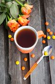 Cup Of Tea And Colorful Candies
