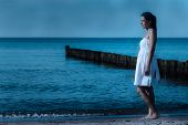 Beautiful Meditative Woman On A Moonlit Seashore
