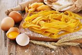 stock photo of pasta  - Still life with raw homemade pasta and ingredients for pasta - JPG