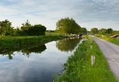 English countryside scene with canal and lock gates