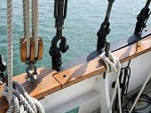 Close-up of rope tied up with pulley and hooks of boat