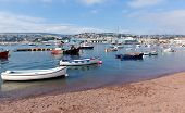 Boats on Teign river Teignmouth Devon tourist town with blue sky a colourful traditional English coa