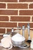 Male luxury shaving kit on shelf, on bricks wall background