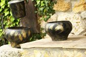 Old retro  cauldrons, outdoors