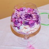 pic of jimmy  - Glass vase full of colourful confetti over a table  - JPG